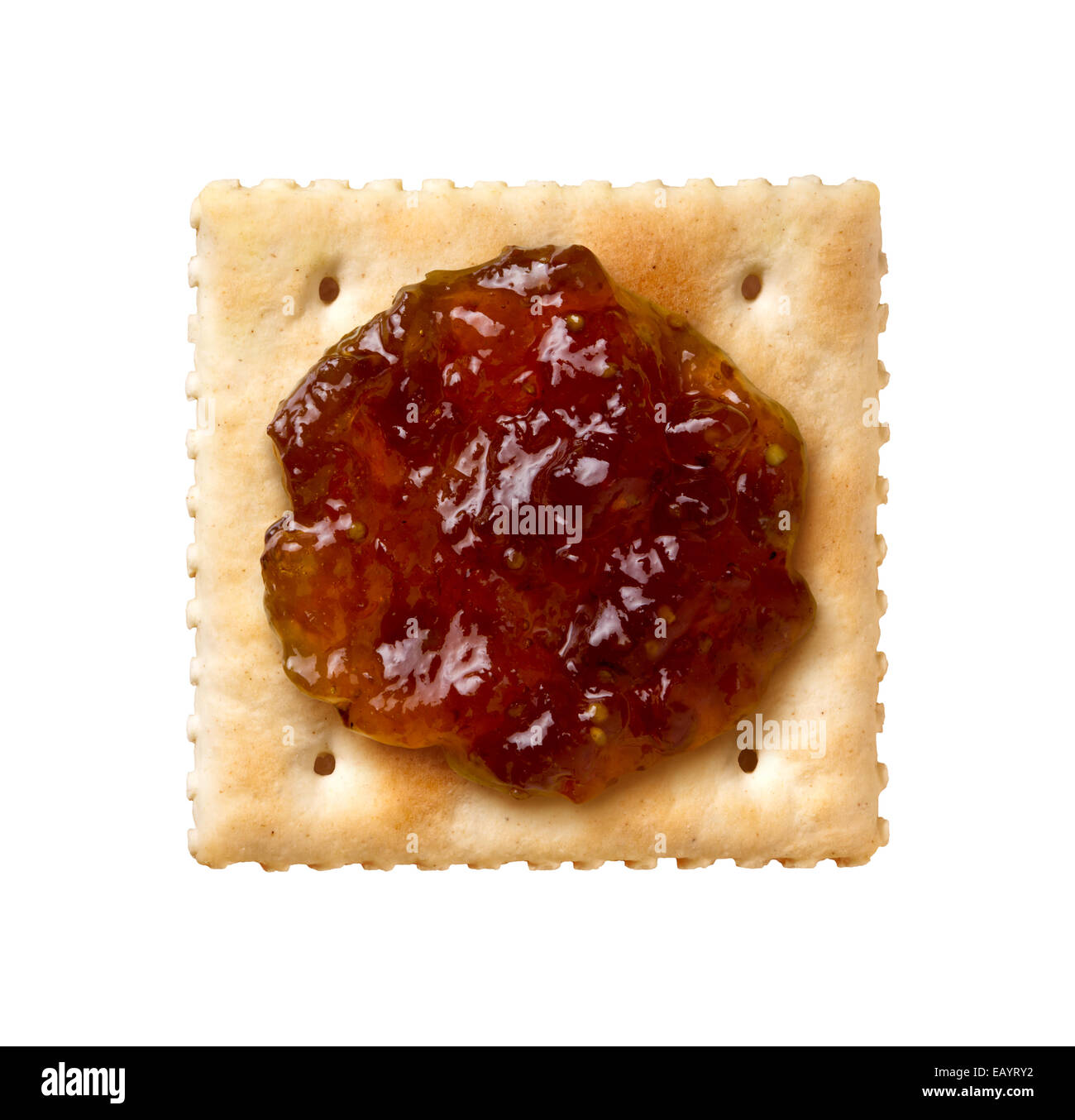 Fig Preserves on a Saltine Cracker isolated on a white background. - Stock Image