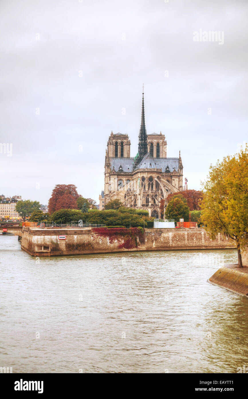 Notre Dame de Paris cathedral on a cloudy day - Stock Image