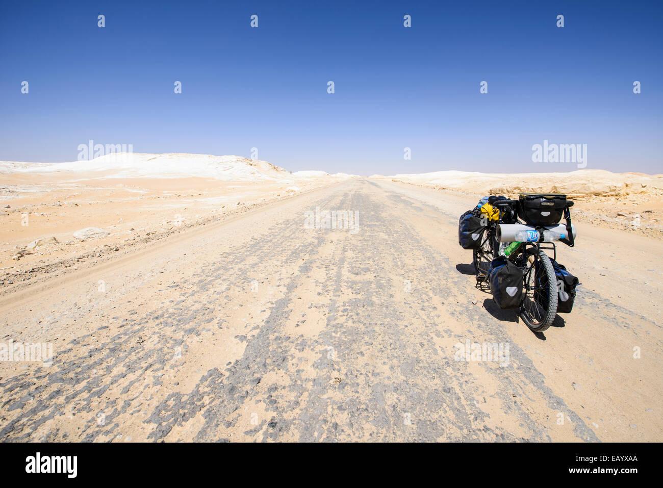 Cycling in the Sahara White desert, Egypt - Stock Image