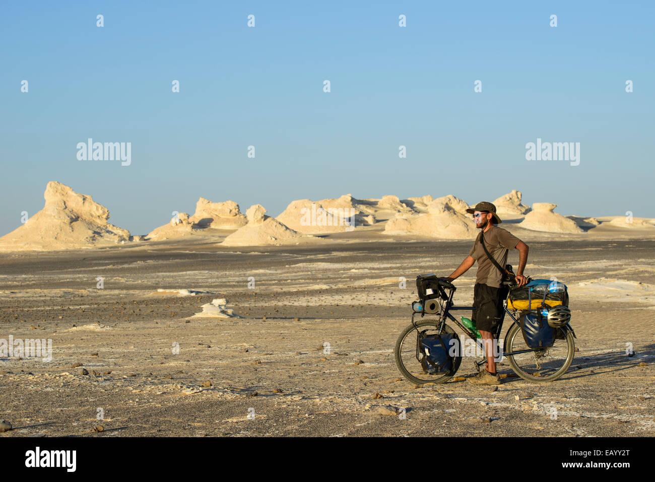 Cycling in the Sahara White desert, Egypt Stock Photo