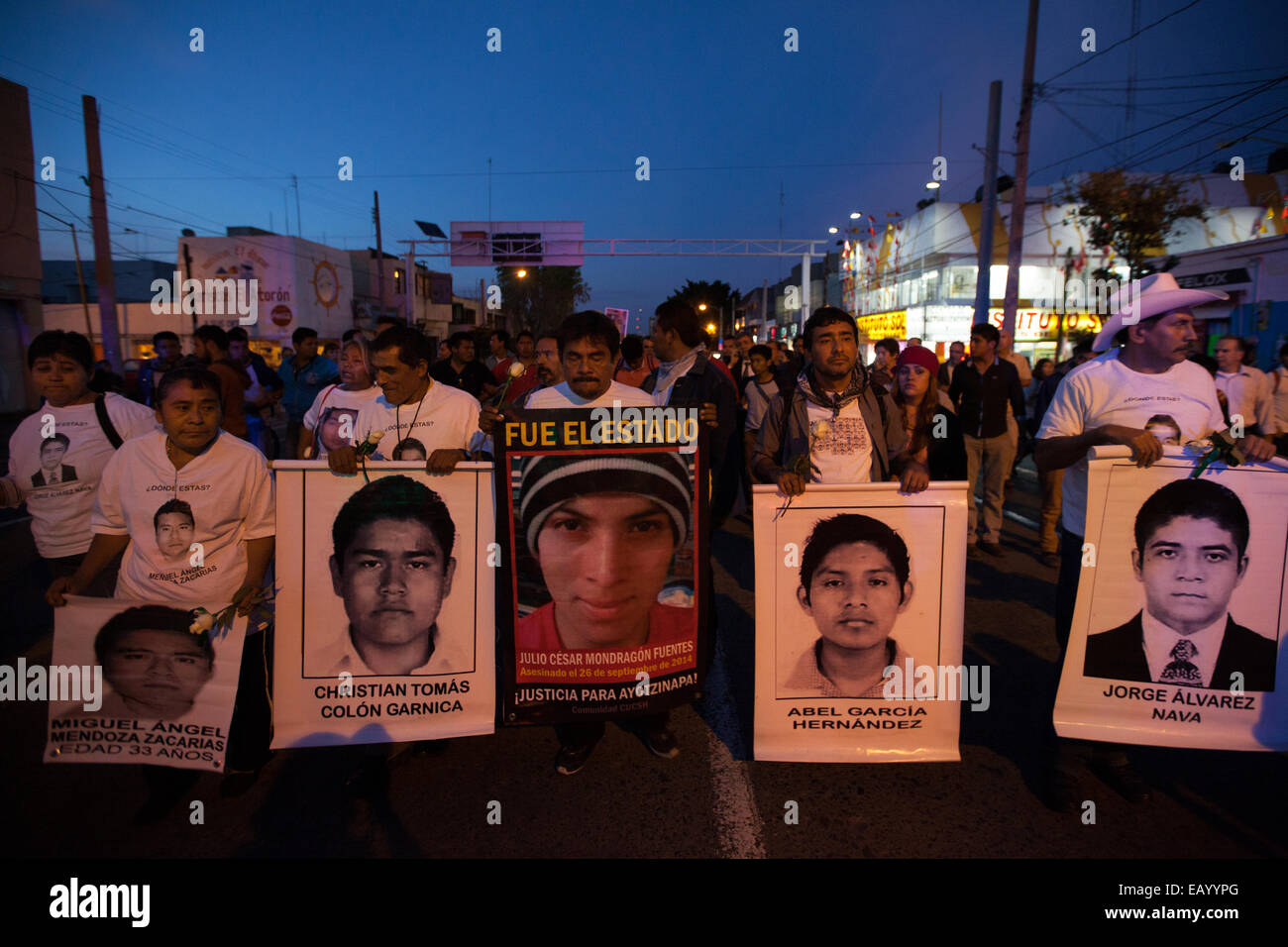 Parents and relatives of the 43 missing students from Ayotzinapa's teacher training college hold images of the missing Stock Photo