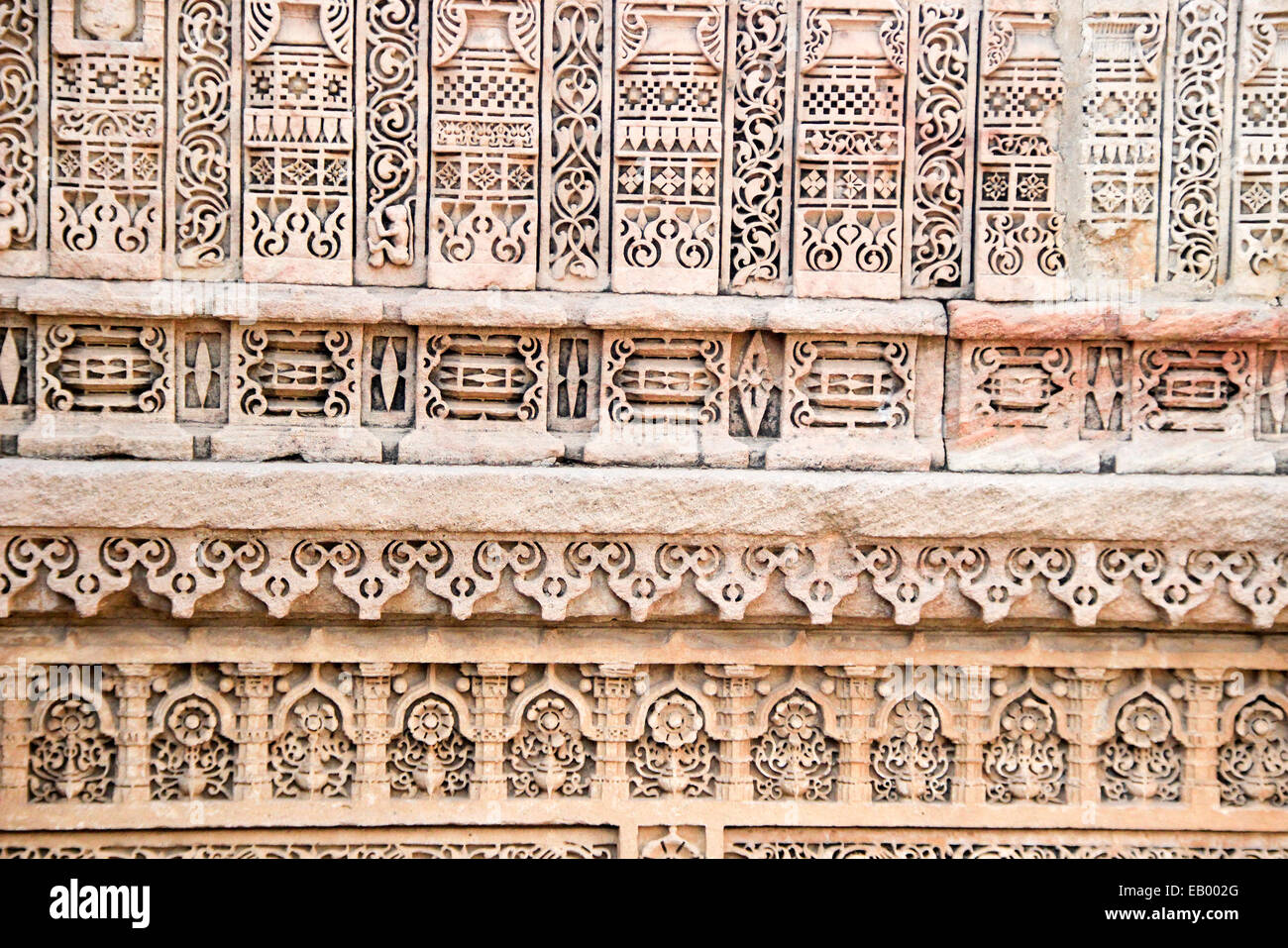Beautiful, intricate, miniature carving on wall at Adalaj Step Well, Ahmedabad, Gujarat, India, Asia - Stock Image