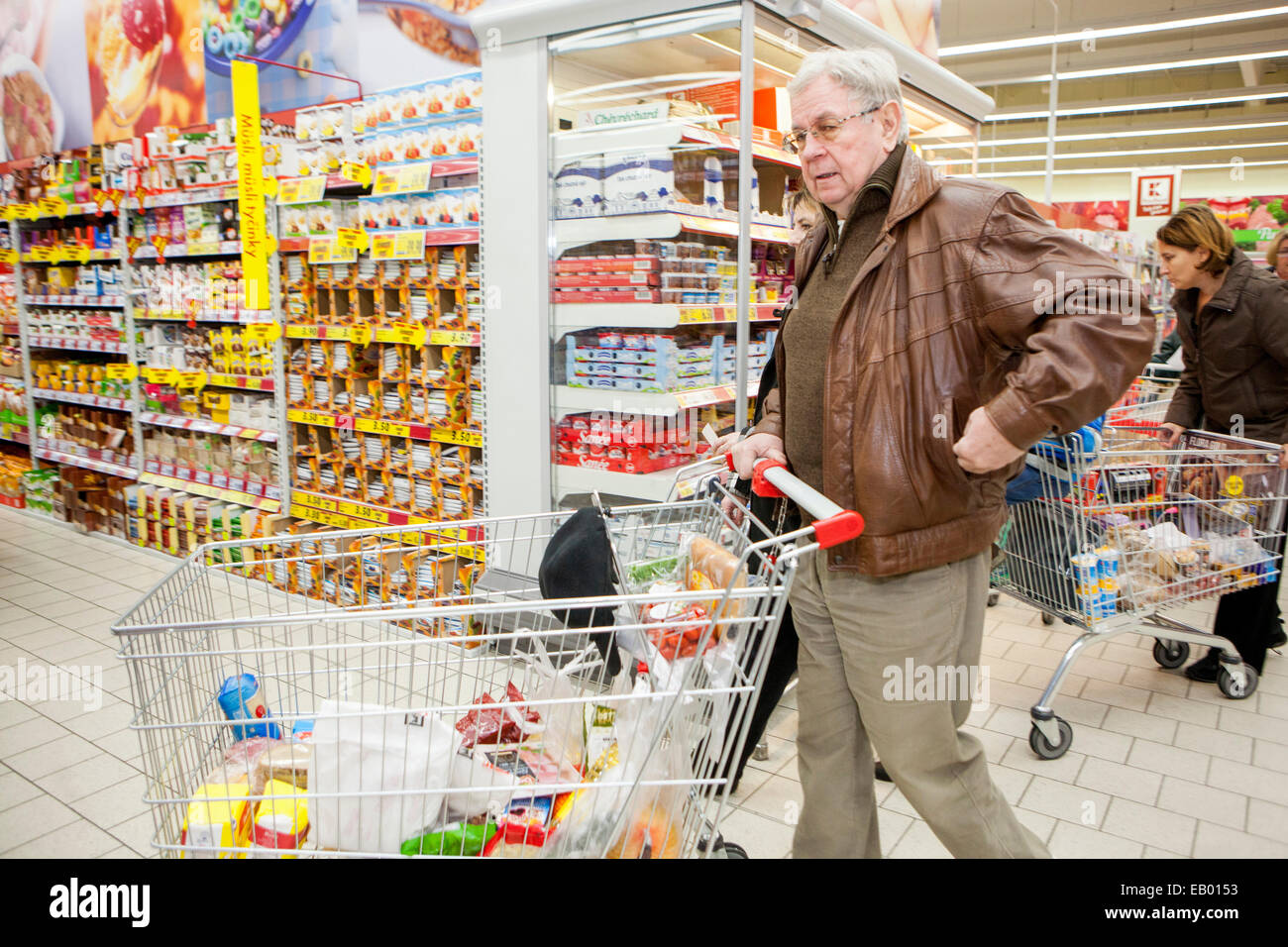 People shopping, Senior man, Supermarket trolley, Prague, Czech Republic Europe - Stock Image