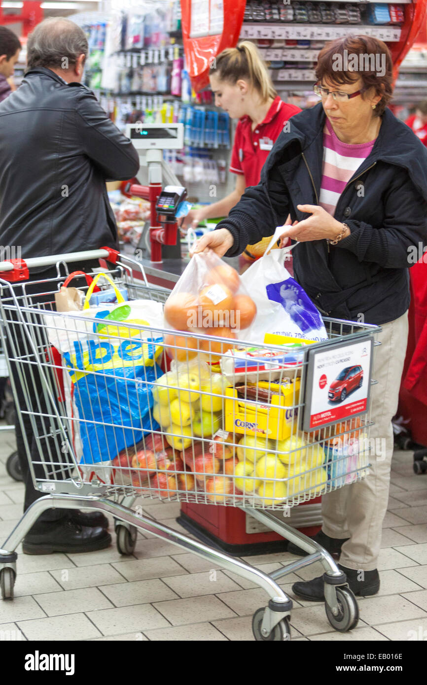 People shopping Supermarket trolley, Prague, Czech Republic Europe - Stock Image