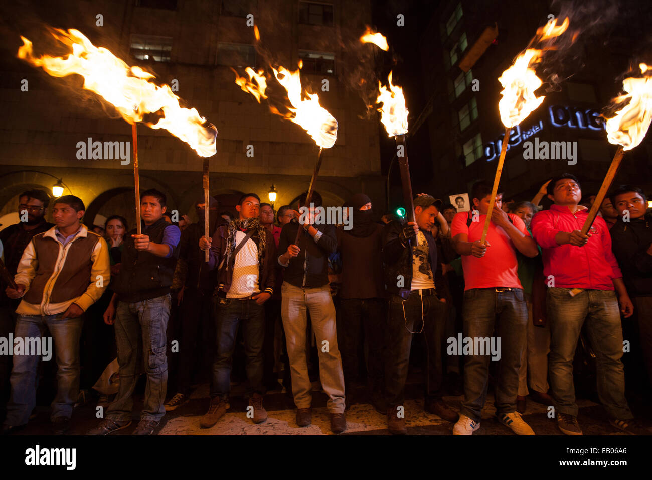 Normalistas students light torches during a march in support of 43 missing students from Ayotzinapa's teacher training Stock Photo