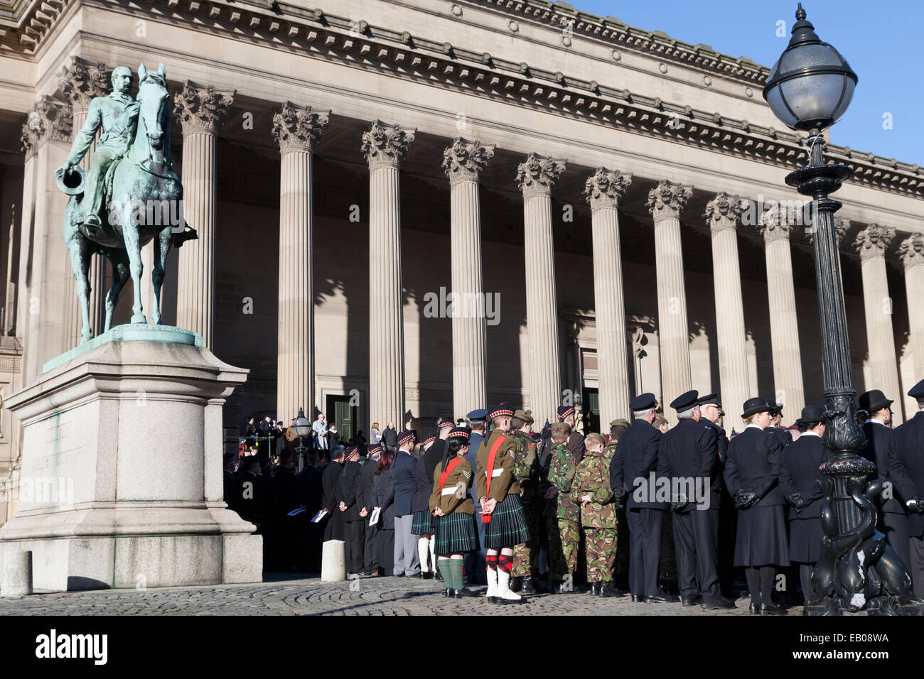 Veterans and serving members of the military line up outside St George's Hall in Liverpool on Remembrance Day - Stock Image