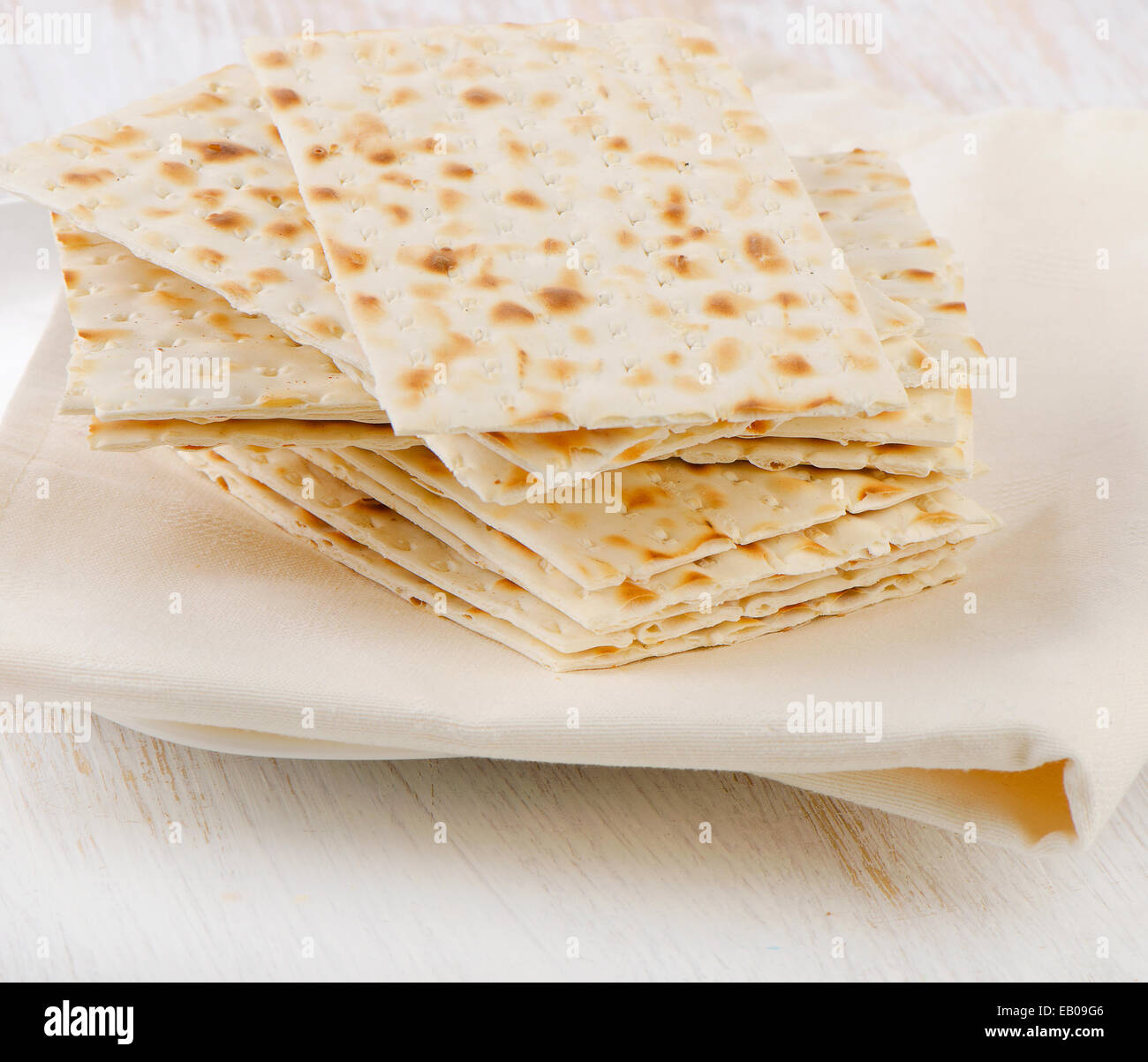 matzoh - jewish passover bread on a wooden table. Selective focus - Stock Image