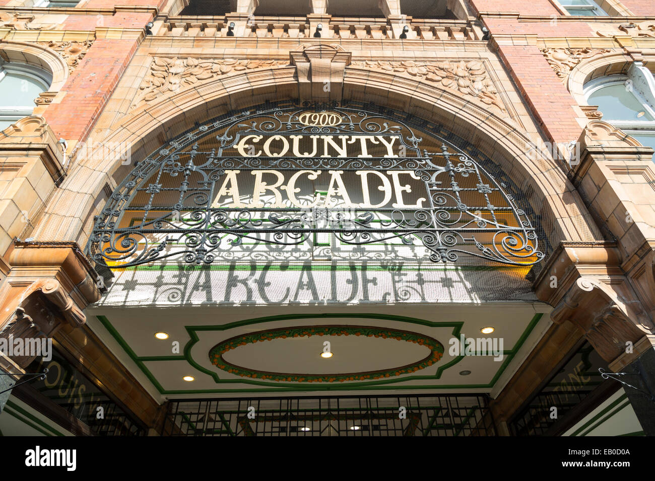 UK, Leeds, Briggate Street, County Arcade sign. - Stock Image