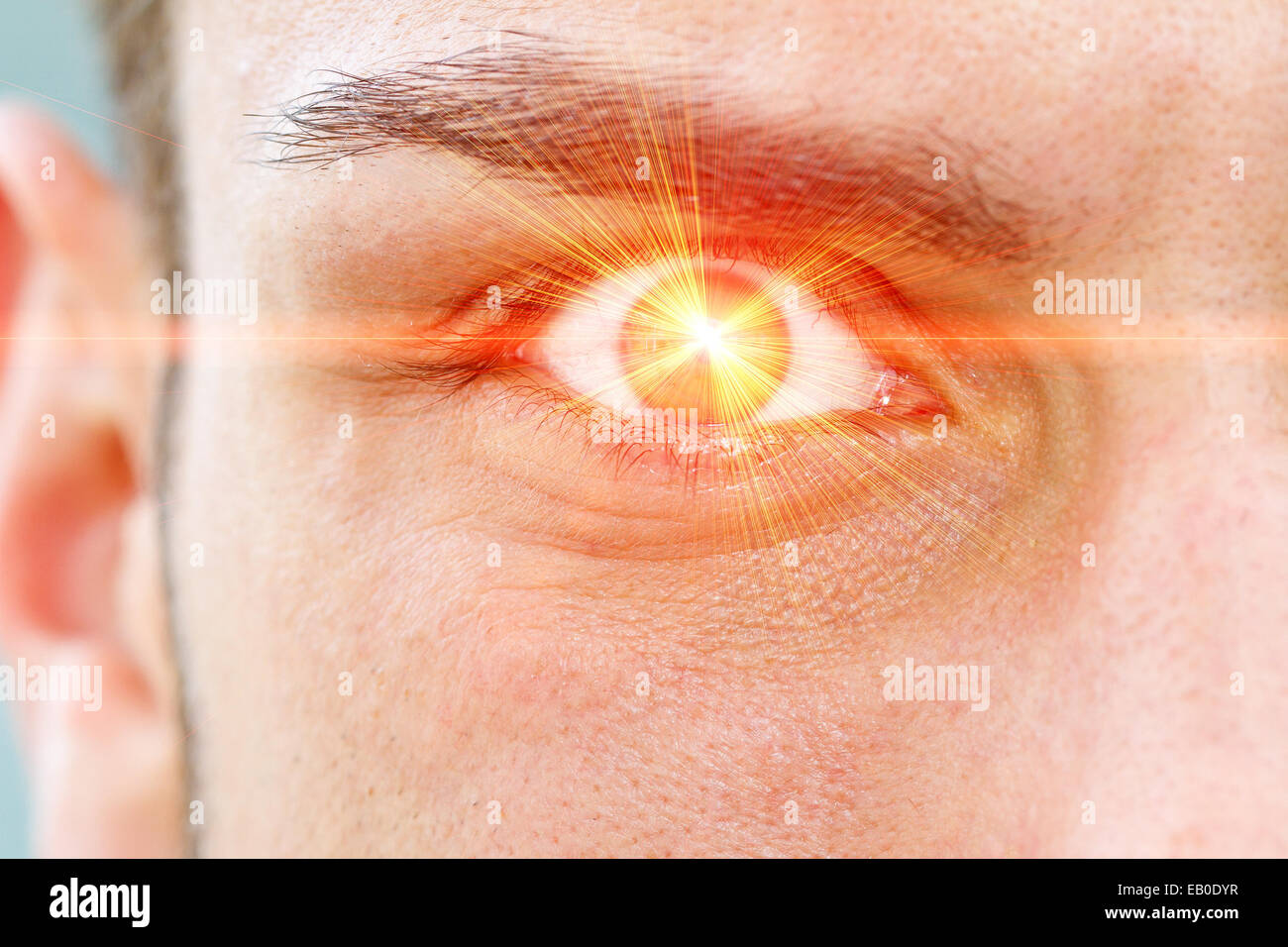 Red laser ray on eye Stock Photo