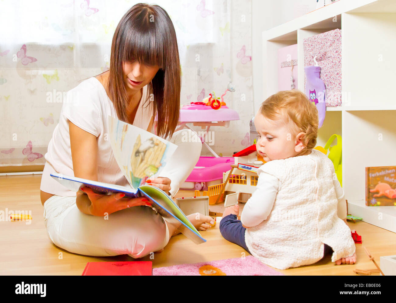 Mother with baby at home - Stock Image