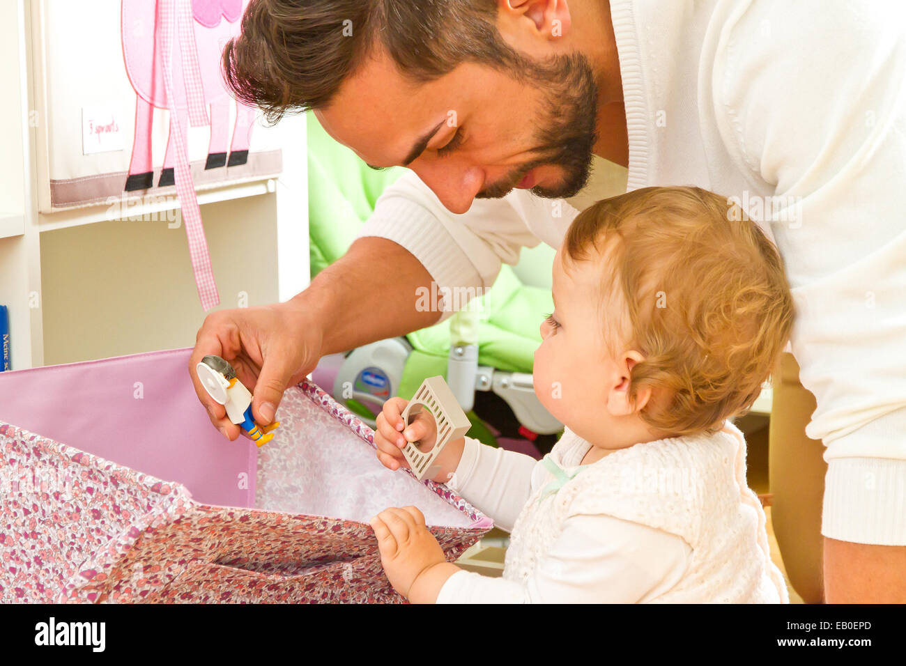 Father with baby at home - Stock Image