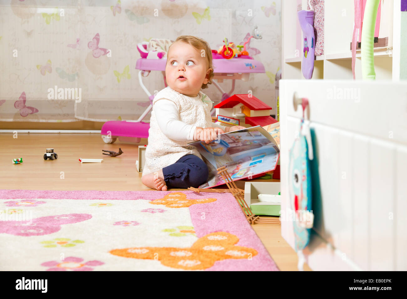Happy, curious baby at home - Stock Image