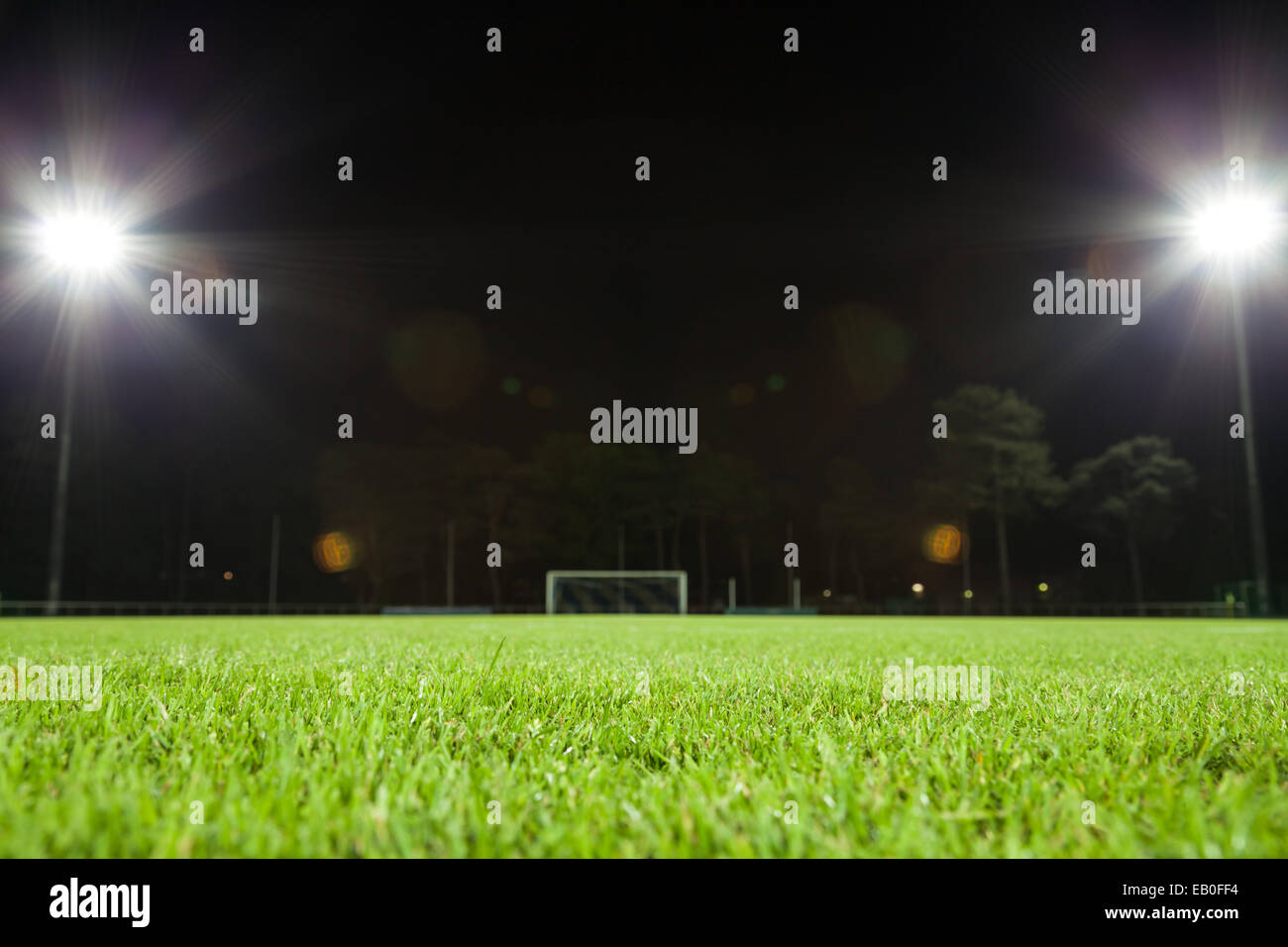 soccer field and goal with spot lights - Stock Image