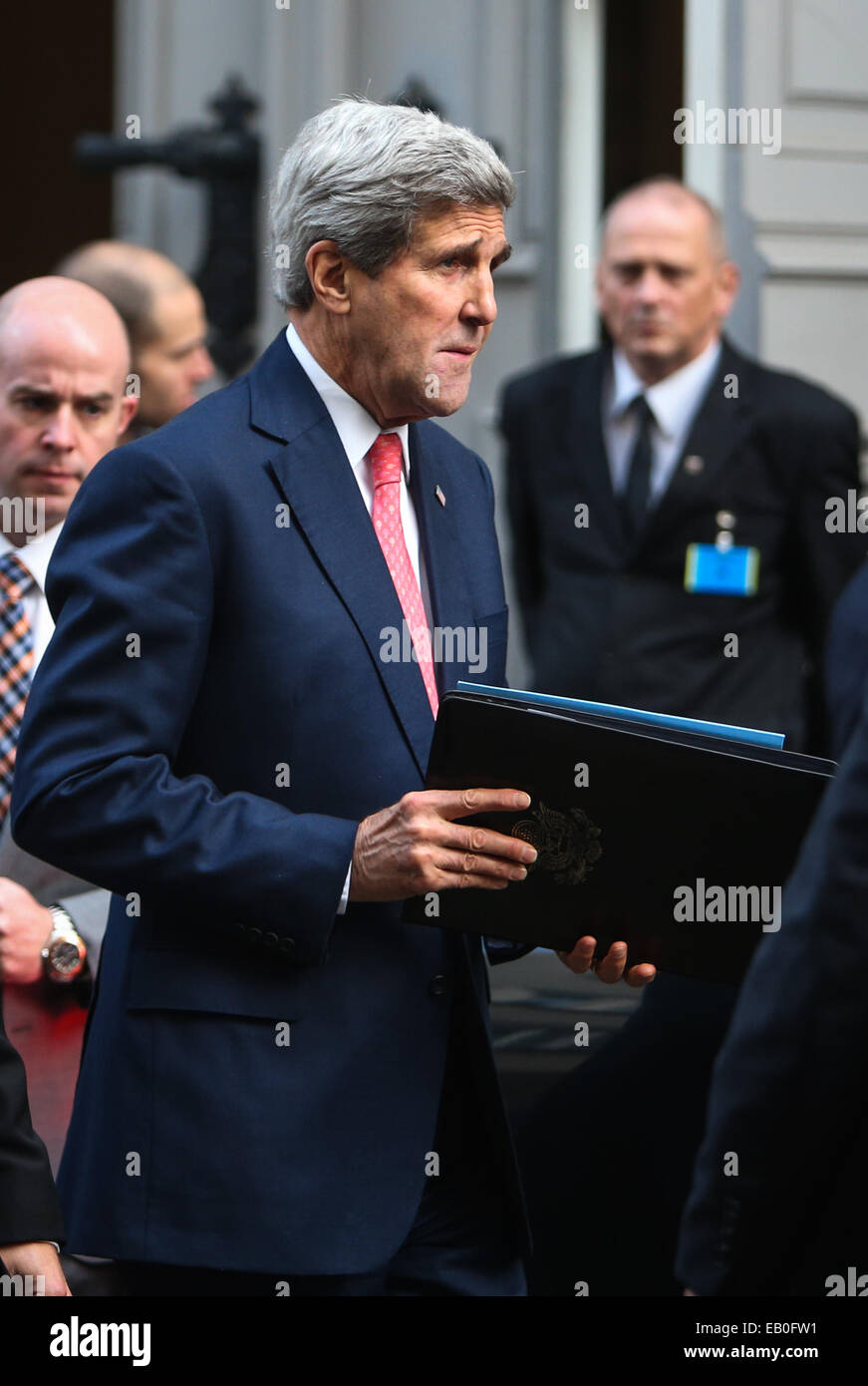 Vienna, Austria. 23rd Nov, 2014. U.S. Secretary of State John Kerry leaves the meeting place of Iran and P5 1 group - Stock Image