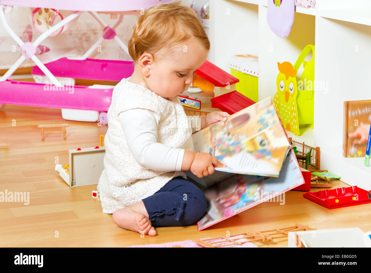 Child looking in to a picture book - Stock Image