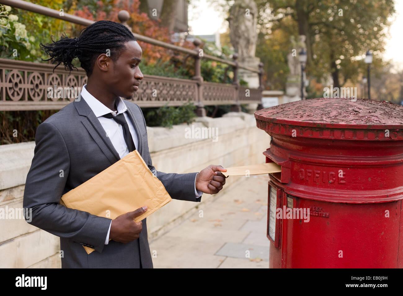 business man sending letters - Stock Image