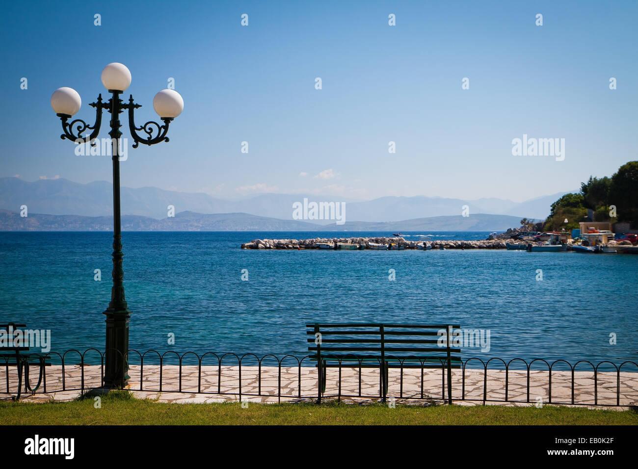 Kassiopi bay on the Greek island Corfu - Stock Image