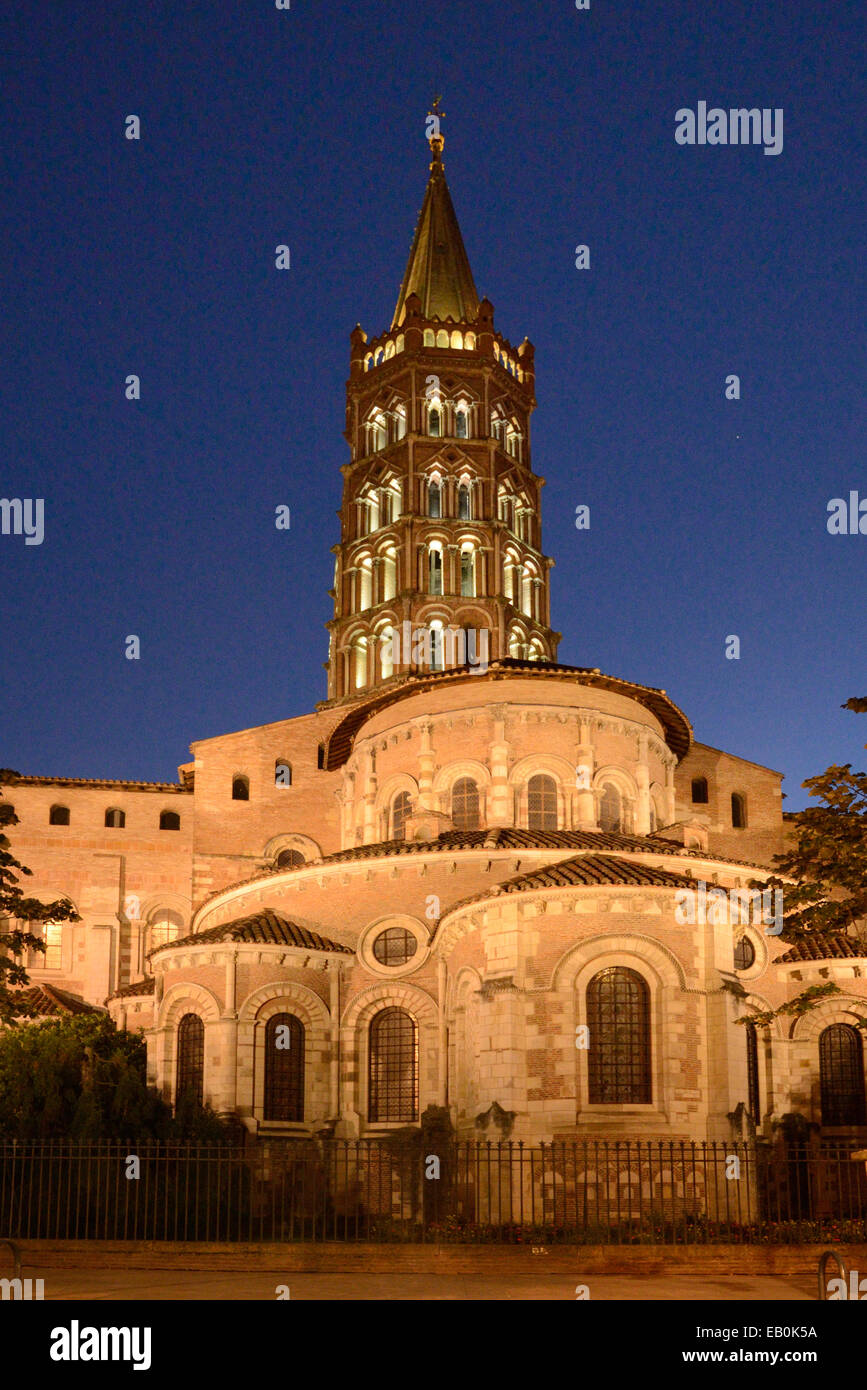 Brick Belfry Church Tower & Spire of the Romanesque Saint Sernin Romanesque Basilica or Church Lit Up at Twilight, - Stock Image