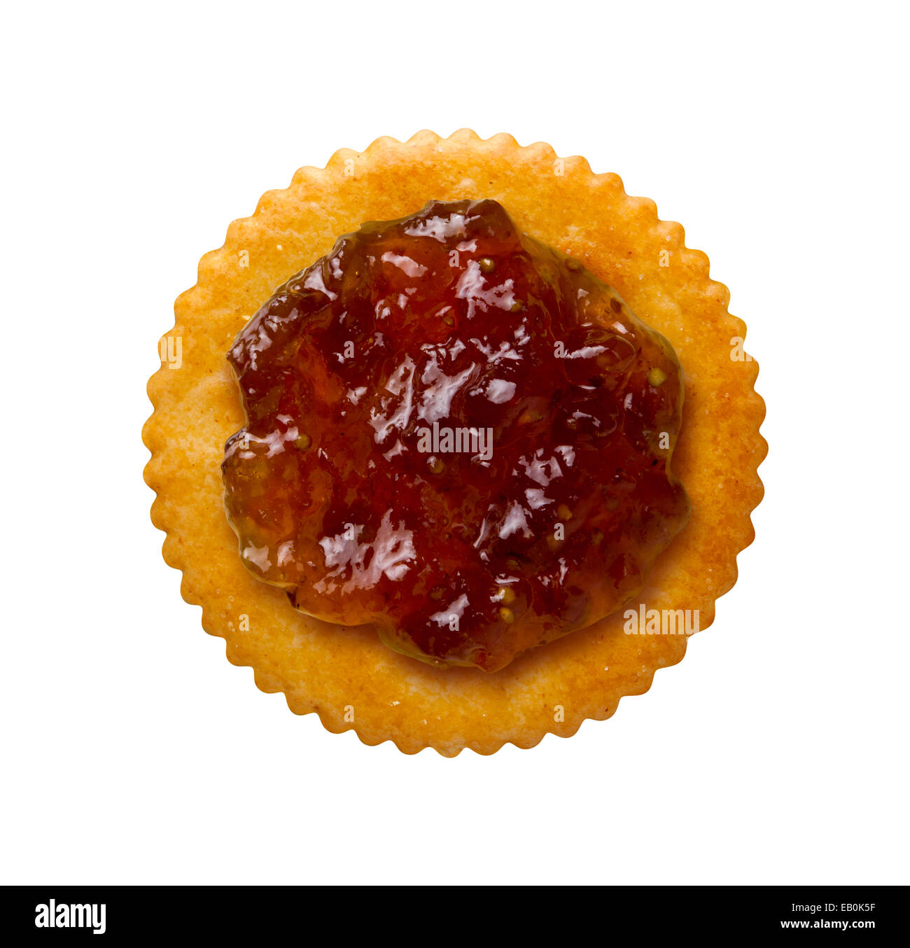 Fig Preserves on a Round Cracker isolated on a white background. Viewed from above. - Stock Image