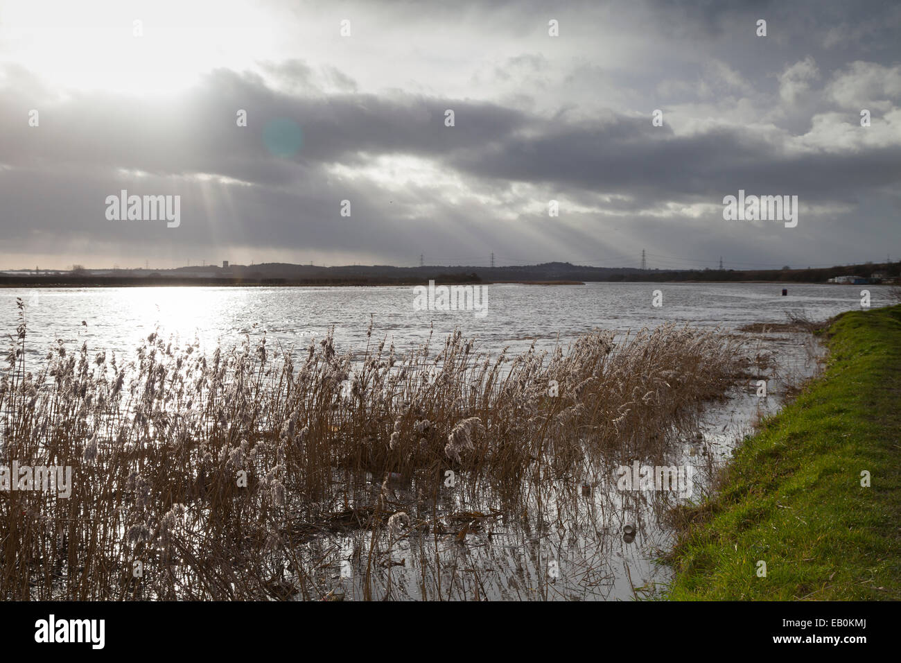 The banks of the River Mersey in Cheshire during a an exceptionally high tide in January 2014. - Stock Image