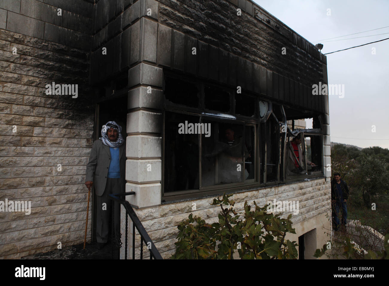 Ramallah, Ramallah. 23rd Nov, 2014. Palestinian are seen in front of the house which was attacked by petrol bombs - Stock Image