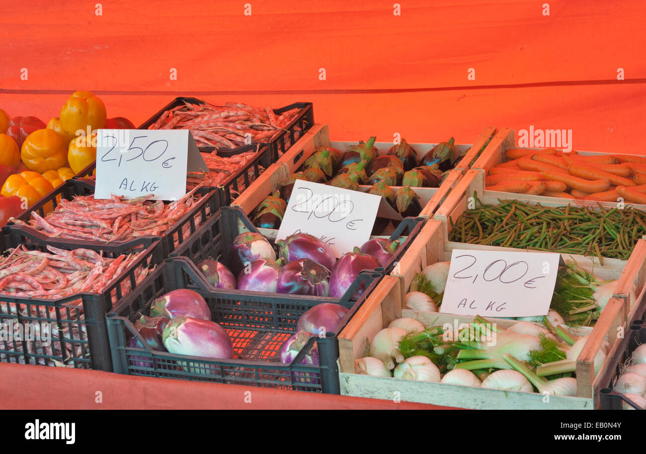 vegetables selling in boxes with a price tag in the italian street market Stock Photo