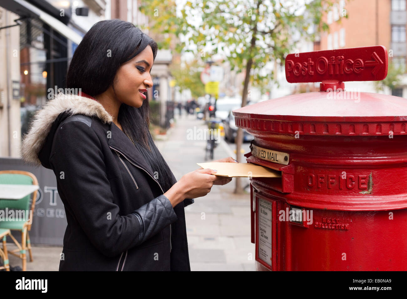 young woman posting a letter Stock Photo