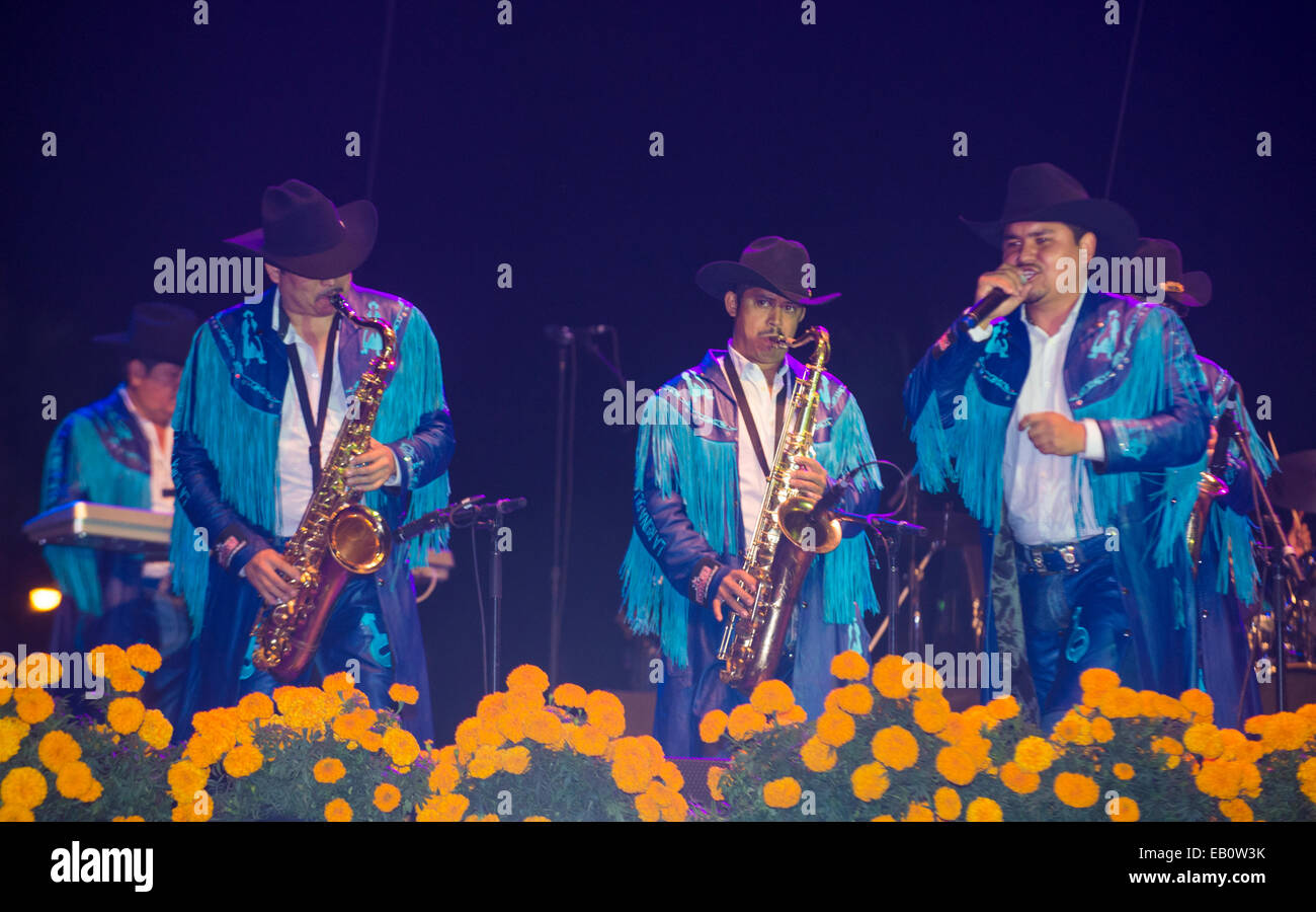 Members of the band Banda Machos perform live on stage at the Dia De Los Muertos celebration in Coachella , California - Stock Image