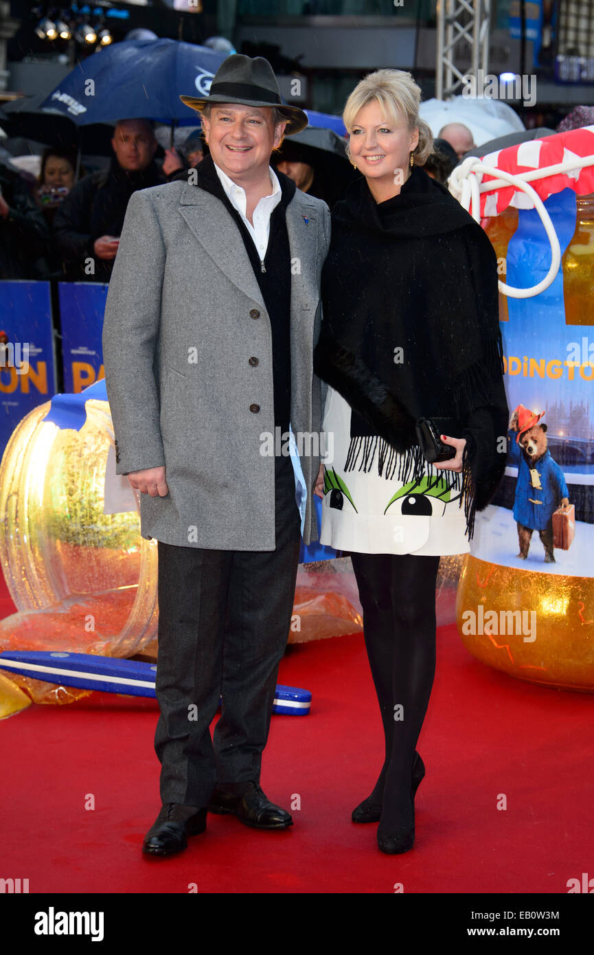 Hugh Bonneville and Lulu Williams at the film Paddington in London. - Stock Image