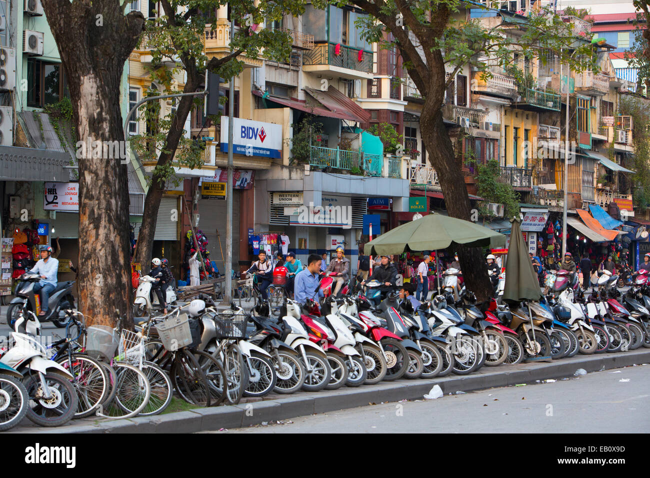 Hanoi street scene of motorcycles in Vietnam - Stock Image