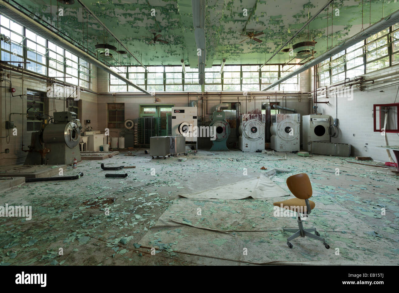 The laundry facilities in an abandoned hospital. Ontario, Canada. - Stock Image