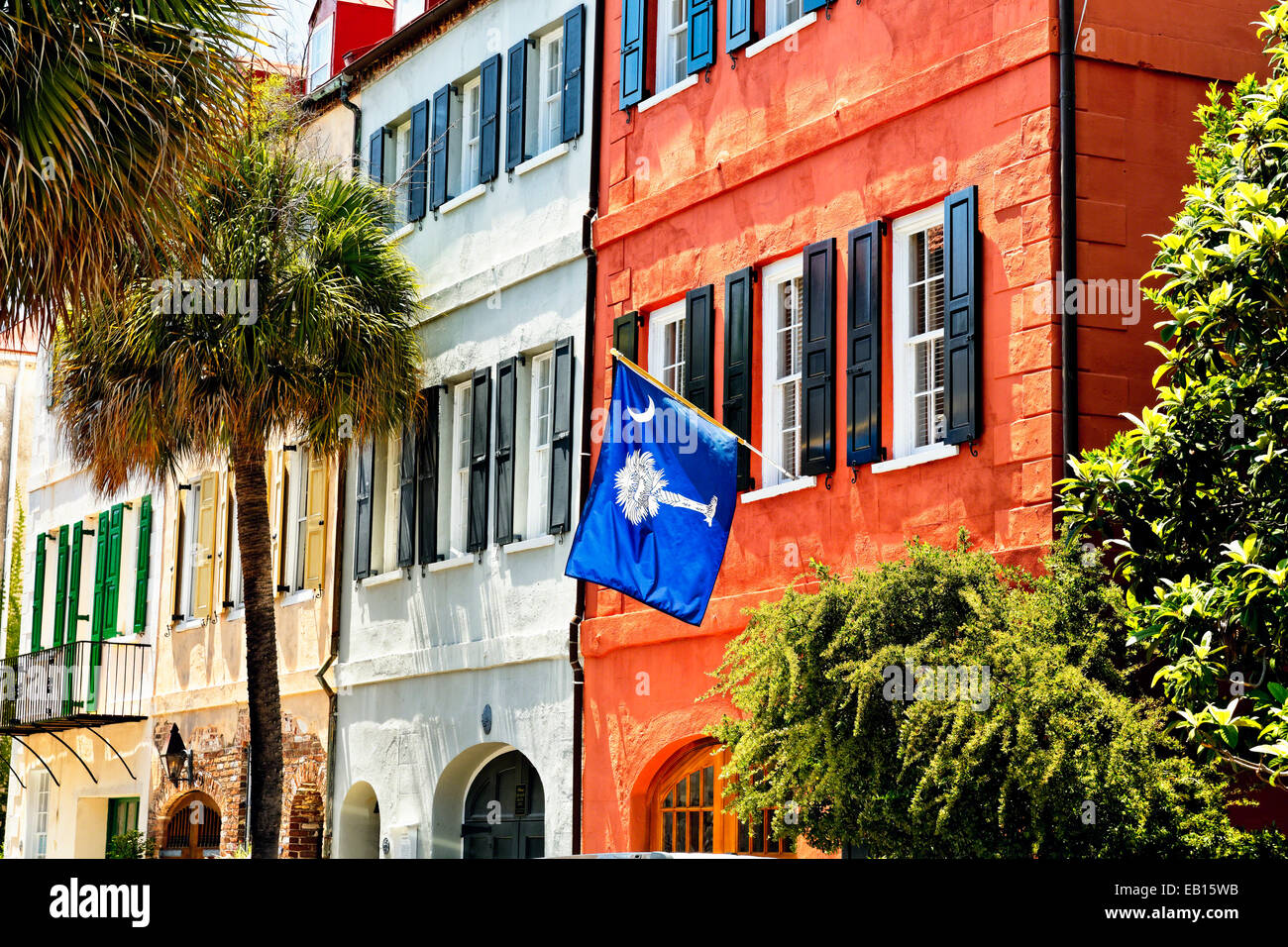 Low Angle View of Colorful House Exteriors with a Flag, Charleston, South Carolina, USA - Stock Image