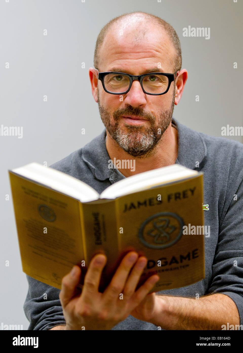Hamburg, Germany. 22nd Nov, 2014. Author James Frey presents his new science fiction novel 'Endgame: The Calling' - Stock Image