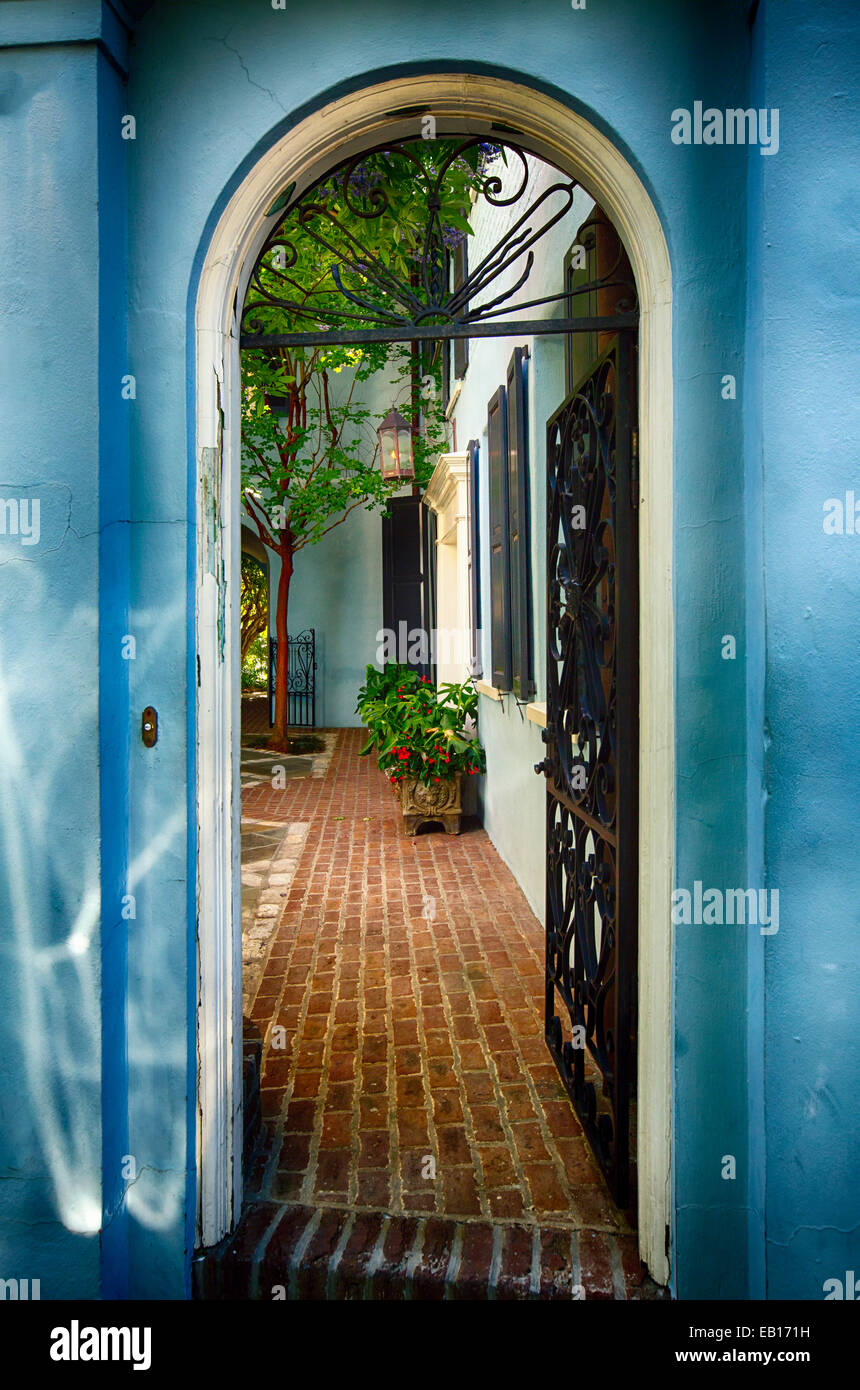 Open Wrought Iron Door to a Historic House, Charleston, South Carolina - Stock Image