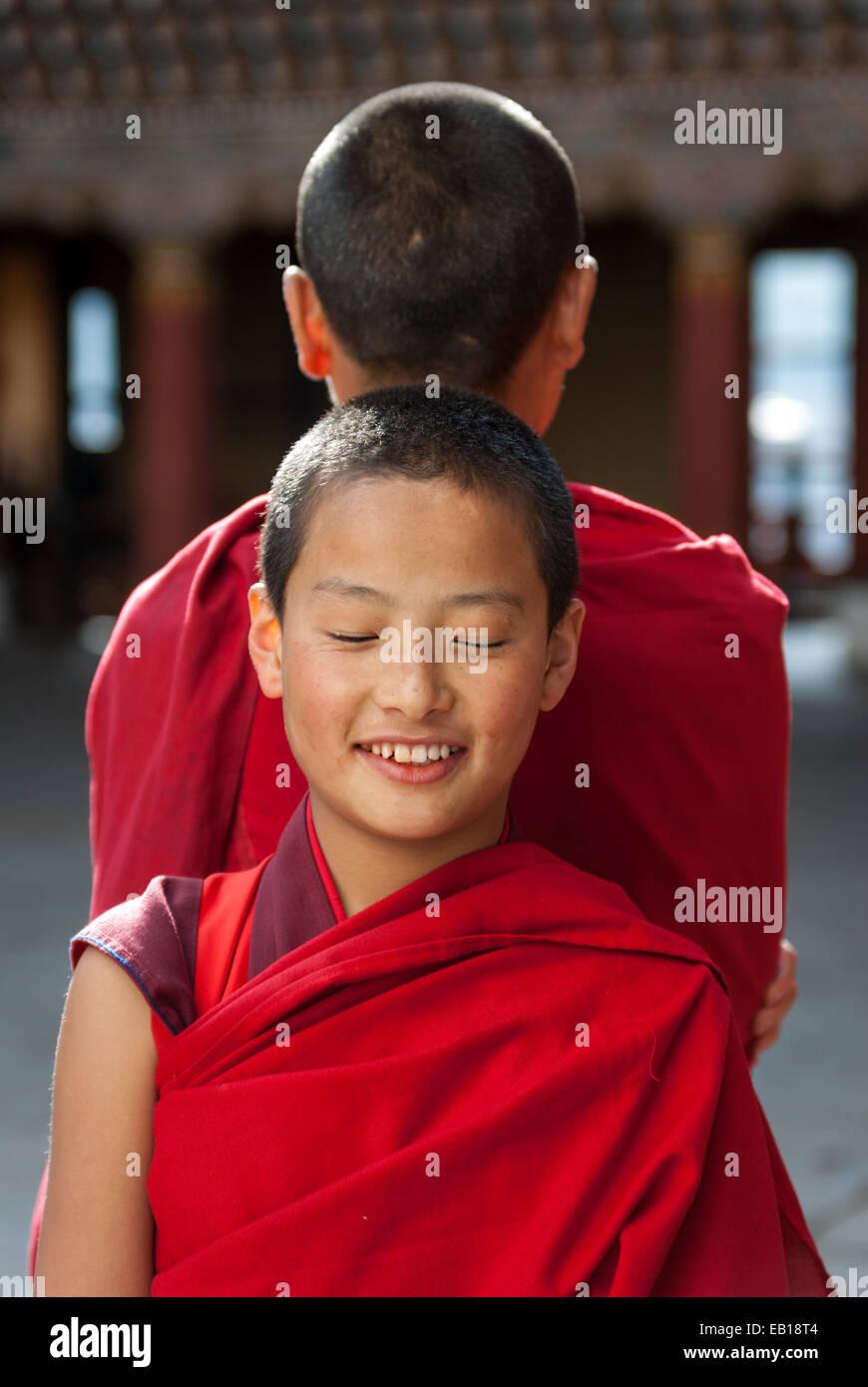 Young Bhutanese Buddhist monks at Paro Dzong, Bhutan - Stock Image