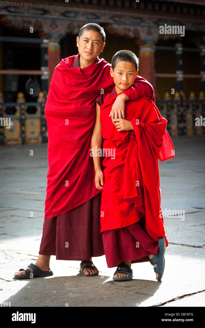 Young Bhutanese Buddhist monks in crimson robes at Paro Dzong, Bhutan - Stock Image
