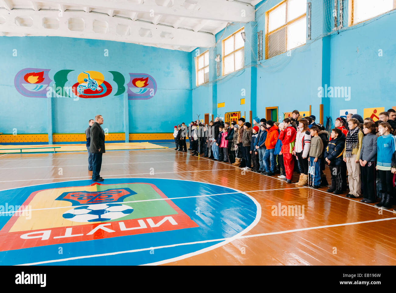 Belarusian secondary school pupils lined up in the school gym before the winter ski competitions. - Stock Image