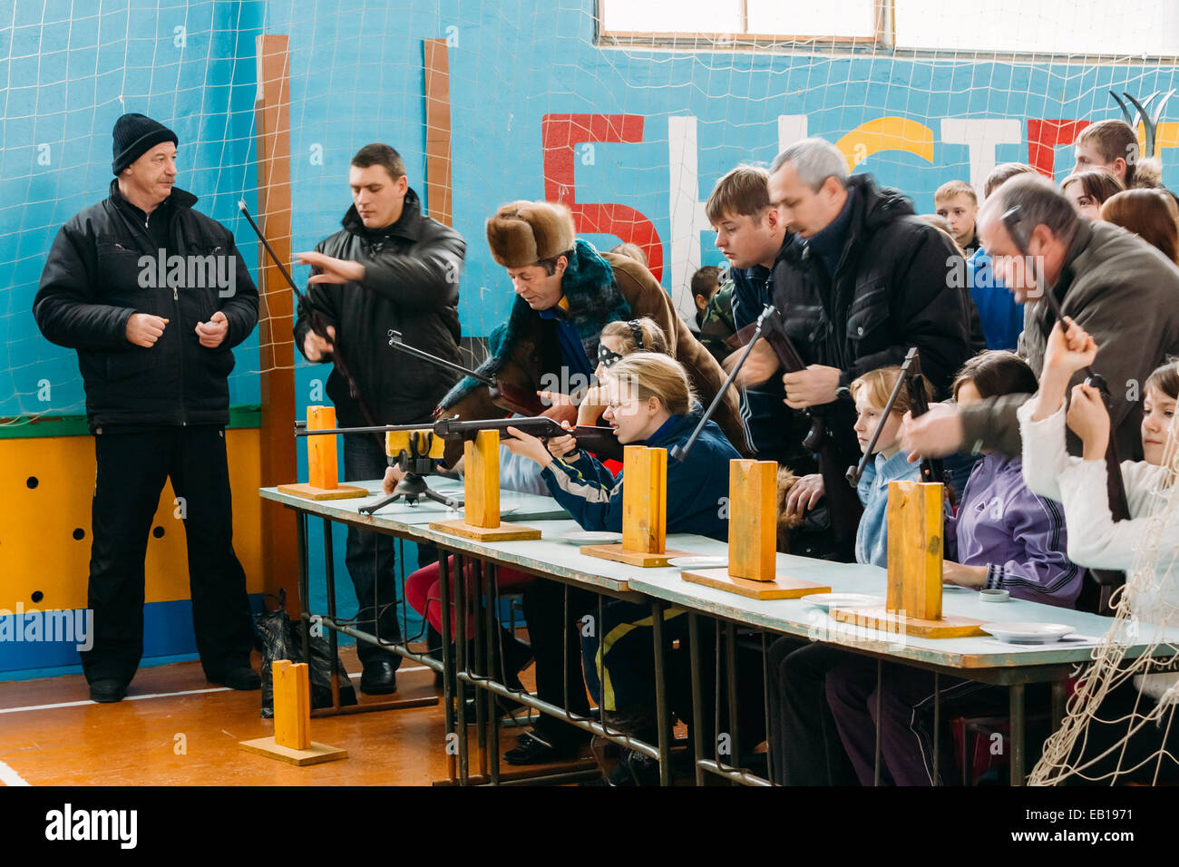 Belarusian secondary school pupils girls shooting an air rifle at a school sports competition 'Ski sniper' - Stock Image