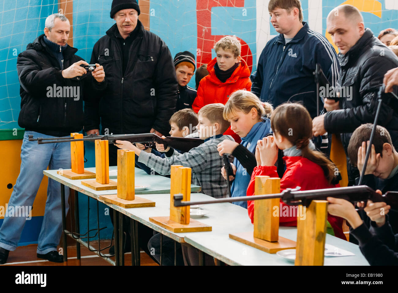 GOMEL, BELARUS - JANUARY 1, 2011: Unrecognizable Belarusian secondary school pupils girls shooting an air rifle - Stock Image