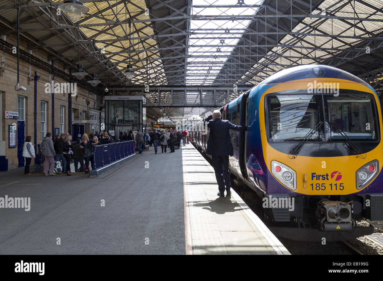 UK, Huddersfield, train station and First Transpennine Express train. - Stock Image