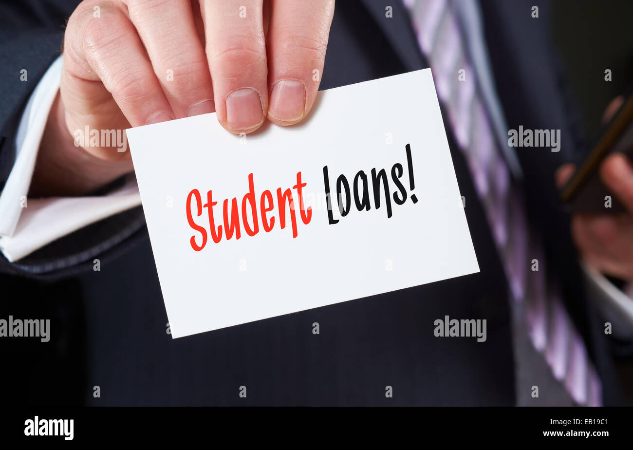A businessman holding a business card with the words, Student Loans, written on it. - Stock Image