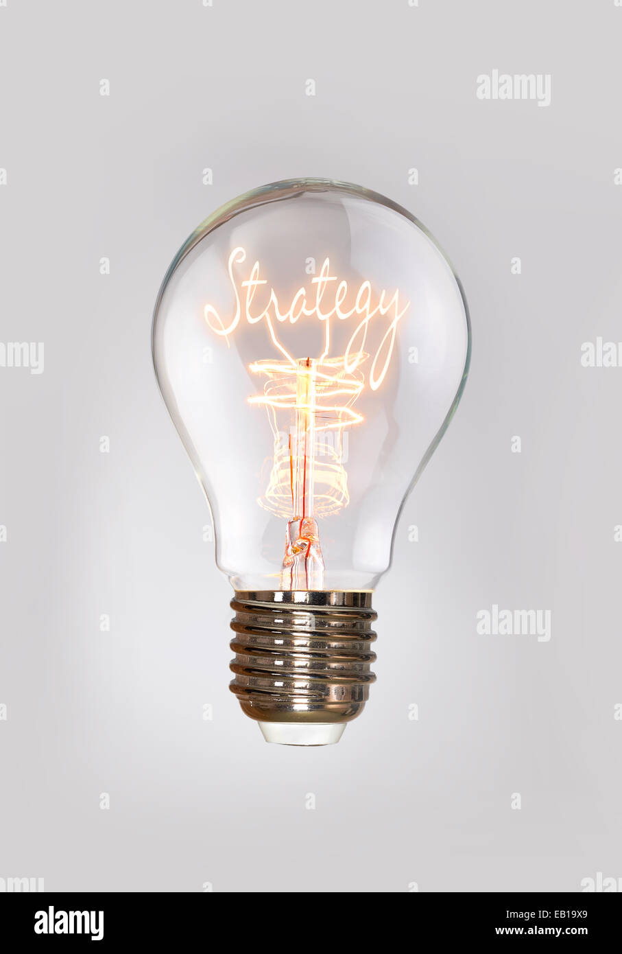 Strategy concept in a filament light bulb. - Stock Image