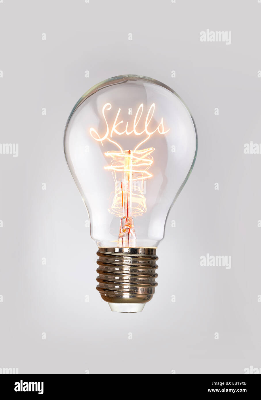 Skills concept in a filament lightbulb. - Stock Image
