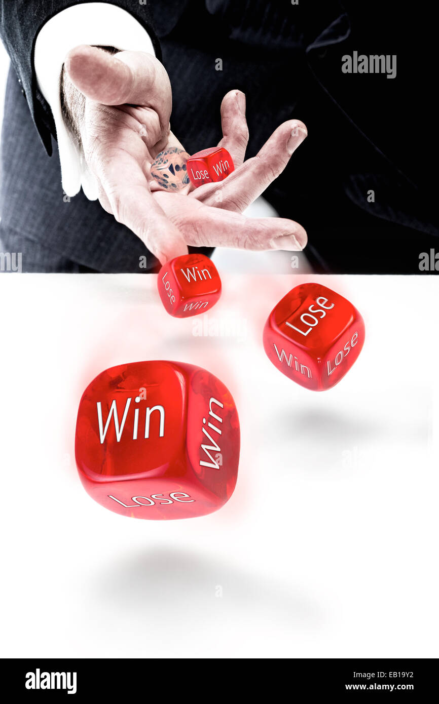 A businessman rolling Win or Lose dice. Win or Lose concept. - Stock Image
