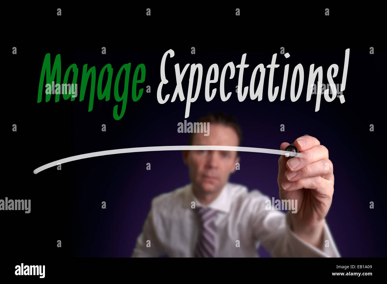 A businessman writing Manage Expectations on a screen. Business Concept. - Stock Image