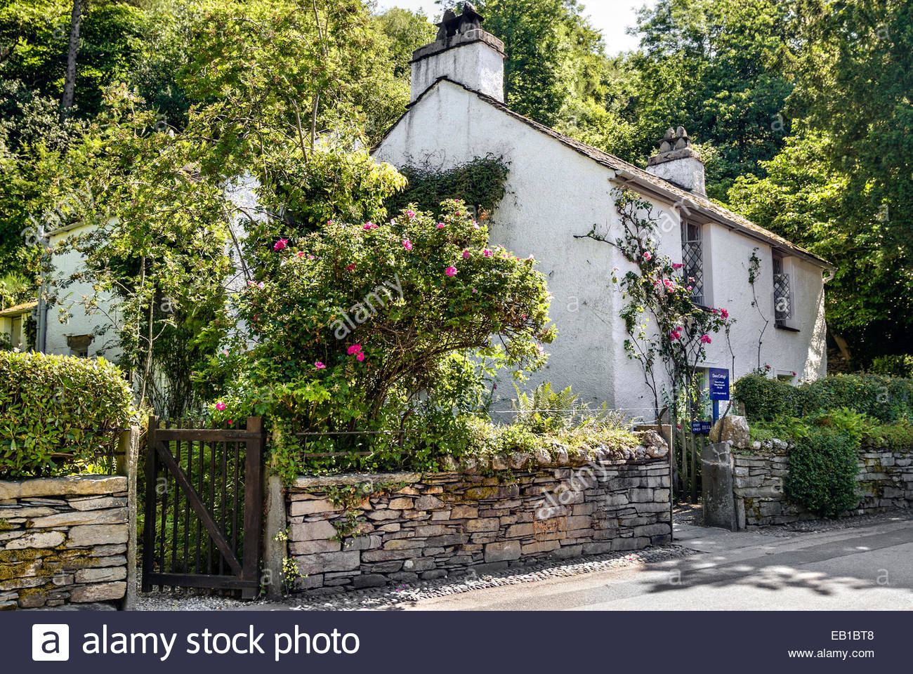 Dove Cottage, a small cottage on the outskirts of Grasmere where the poet William Wordsworth lived from 1799. - Stock Image