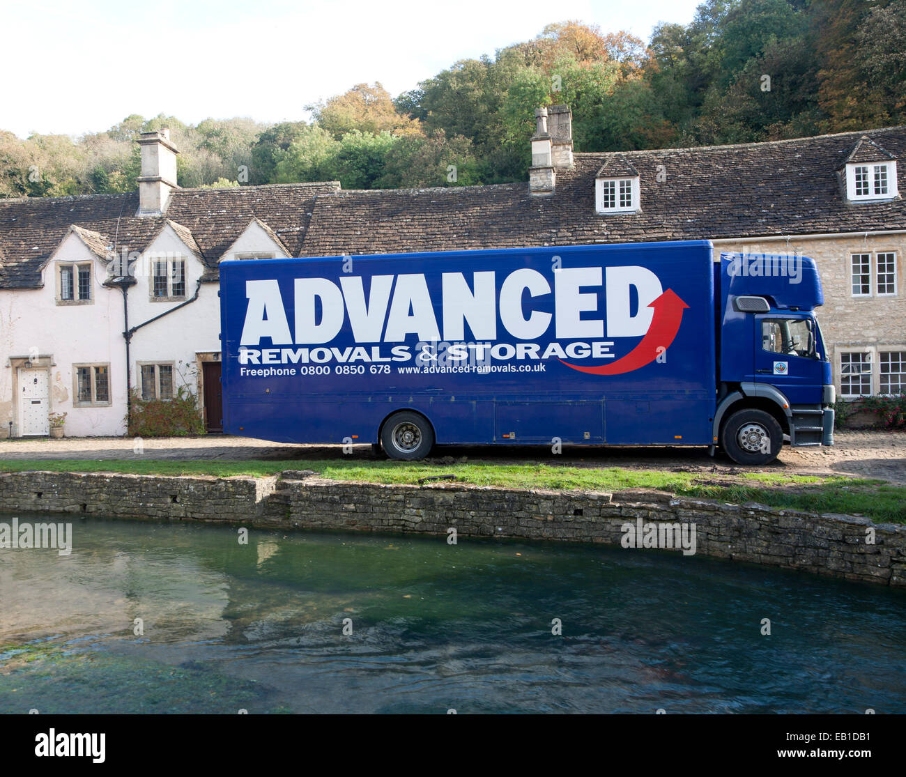 Removal van in Castle Combe, Wiltshire, England, UK claimed to be England's prettiest village - Stock Image