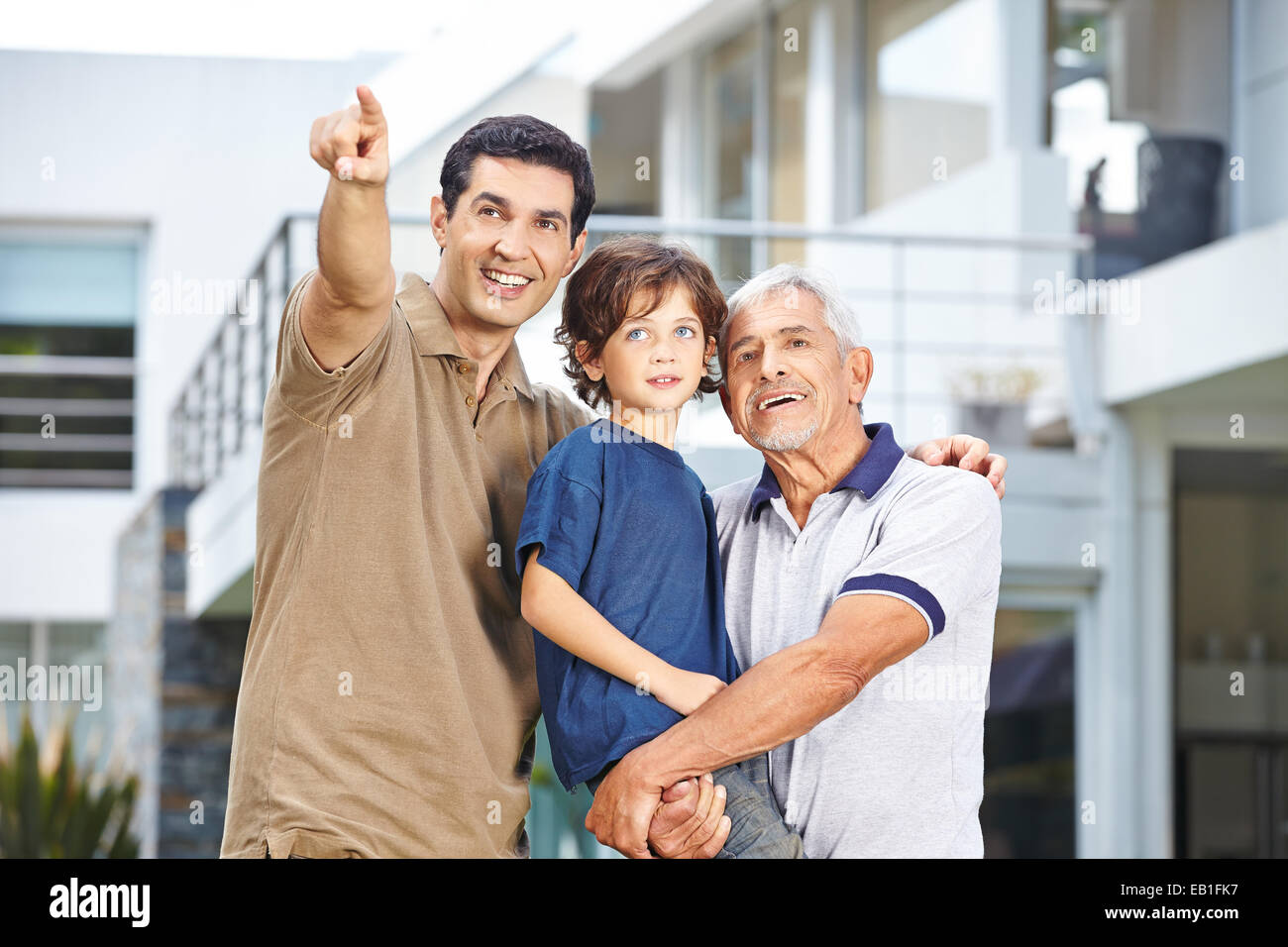 Father of family with son and grandfather showing future goal - Stock Image
