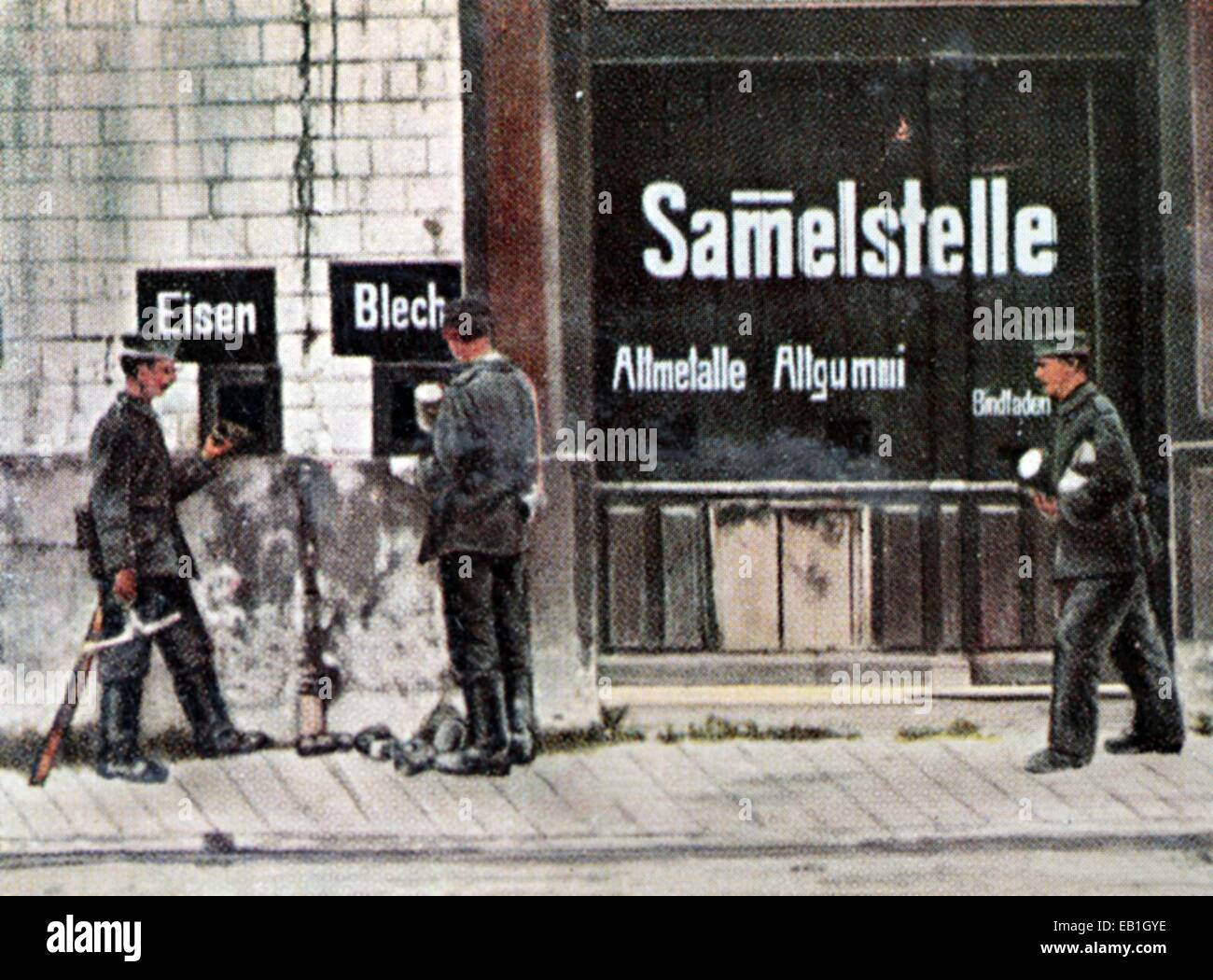 The contemporary colorized German propaganda photo shows a collection site for old materials such as iron, brass, Stock Photo
