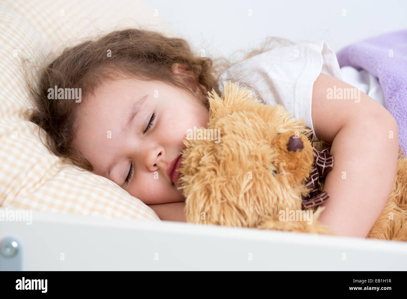 Pretty kid girl sleeping in bed - Stock Image